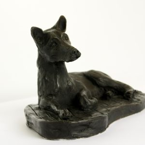 cold cast bronze dog lying down